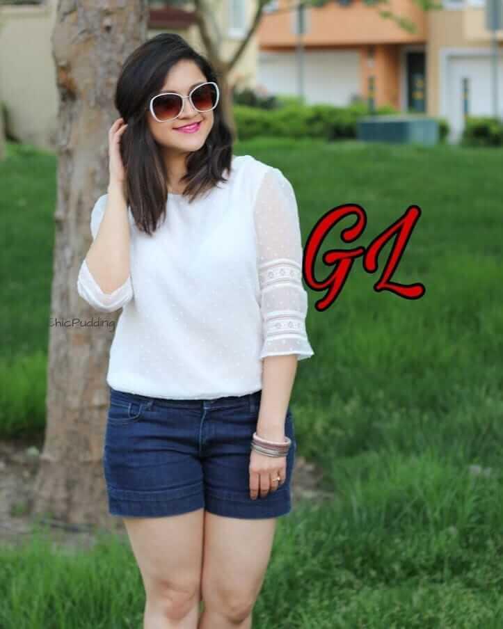 An Instagram girl in denim shorts
