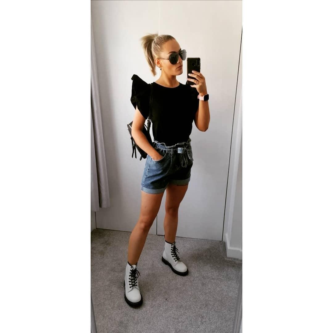 A girl in blue denim fashionable short shorts