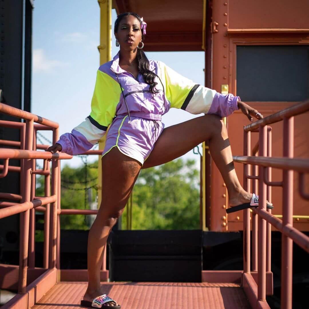 A black woman wearing Gym short shorts