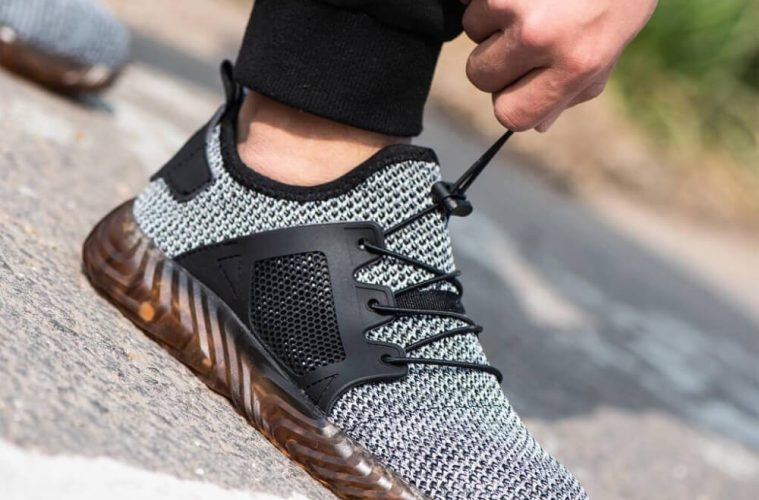 A guys shoe lacing of his Indestructible Shoes